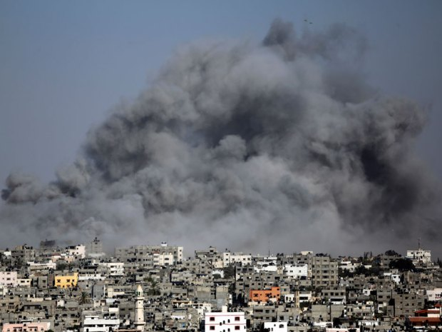 Above, smoke from an Israeli strike rises over the Gaza Strip, Friday, July 25, 2014.