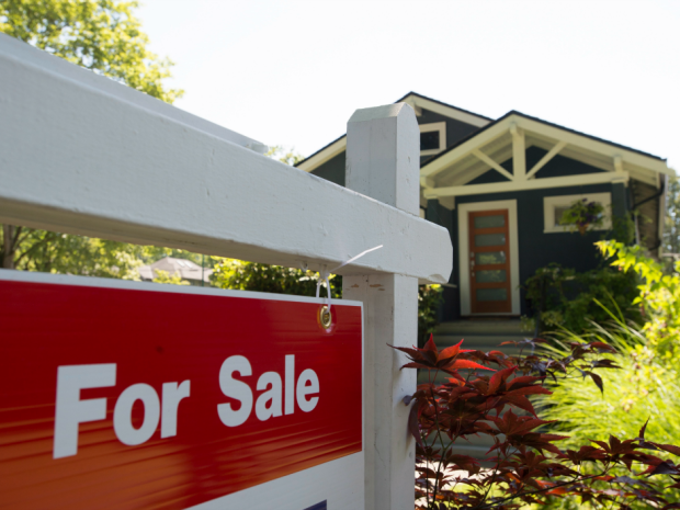 A sold sign is pictured outside a home in Vancouver, B.C. The Canadian Press/Jonathan Hayward.
